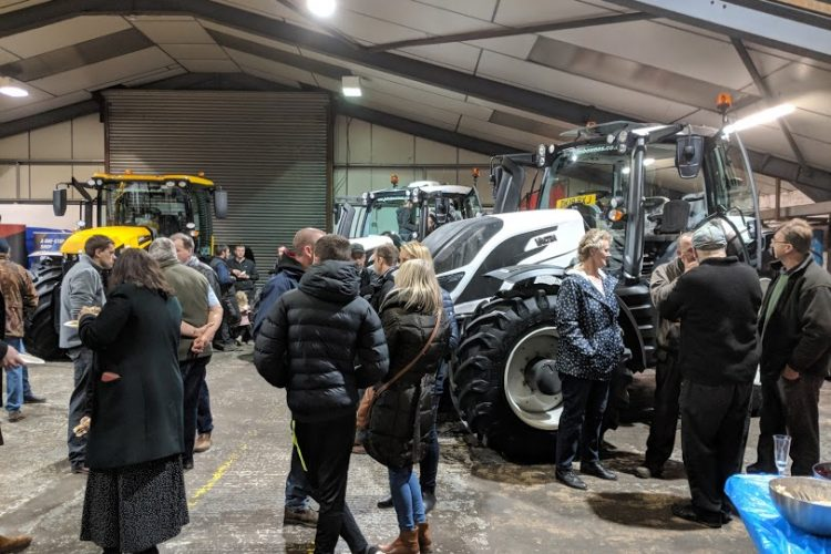 John Bownes 150 year anniversary event, customers chatting and admiring the range of tractors